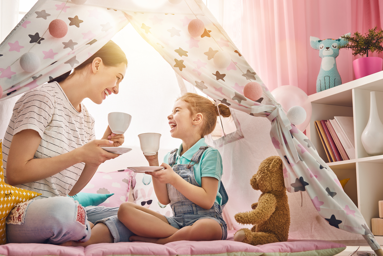 Happy loving family. Mother and her daughter girl play tea-party